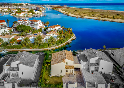 LUXURY PROPERTY on a EXCLUSIVE GATED RESIDENCE overlooking a Lagoon with views to the Sea beyond - SAINT CYPRIEN.
