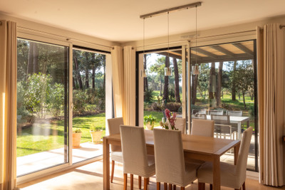 Exceptional modern villa in private gated residence, 700m from the beach with separate guest accommodation overlooking golf fairway.