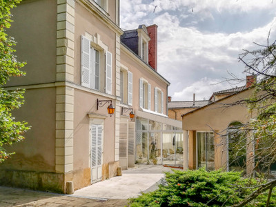 Stunning six-bedroomed mansion, heart of historic Thouars, hidden behind high walls and impressive gates. Lift, indoor swimming-pool complex, outbuildings, private grounds.