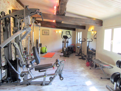 Exceptional quality stone chambres d'hotes, gite and apartment complex with pool, fitness suite, sauna, hamman, parking and mountain views. Prades.