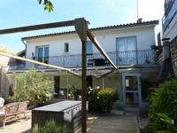 Maison de ville avec garage et jardin