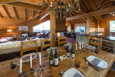 For sale; Fully furnished 5 bedroom chalet with outdoor hot tub & private parking - sleeps 10. Situated in La Tania, Courchevel at an altitude of 1400 m this luxuriously decorated chalet is tucked in a tranquil neighbourhood with the ski slopes just 50m from the doorstep. The lounge & dining area on the top floor is centred around an impressive stone fireplace with spectacular mountain views.