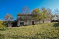 Très belle grange en pierre à rénover, position dominante avec vues, permis de construire accordé.