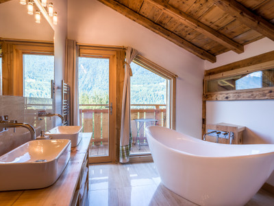 Located in a haven of peace with 360° mountain views in a sunny location near Morillon and Samoens – for sale, a beautifully renovated seven-bedroom, traditional French Savoyard farmhouse, dating back to 1746. 