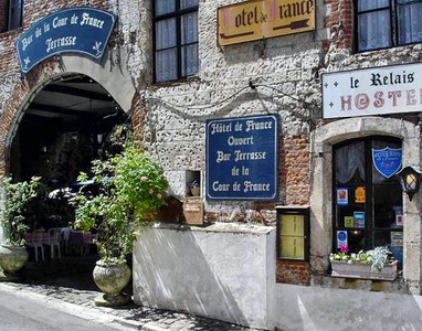 Magnificent former 16th century coaching inn - the inspiration for Hugo's 'Les Miserables' - in the heart of Montreuil sur Mer offering 12 bedrooms, two apartments and courtyard garden.