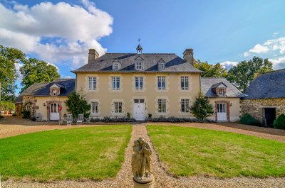Elegant, manor house tastefully decorated throughout, set in over 3 hectares with country views and numerous outbuildings.