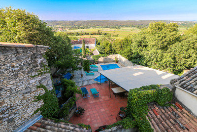 Magnificent full of character 18th century property with established rental business with 10 bedrooms, 7 bathrooms, courtyard with pool, garage, terraces in charming village near Uzès and close to the Pont du Gard.
