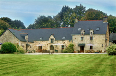 This stunning collection of 16th century stone buildings includes a 'petit manoir', guest cottage and longère set in a peaceful rural location in over three acres of woodland and beautifully landscaped gardens, which feature a heated swimming pool and sun terrace.