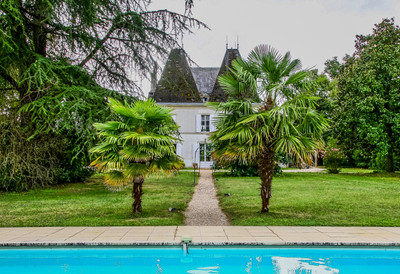 Magnificent riverside chateau with second guest house and pool.