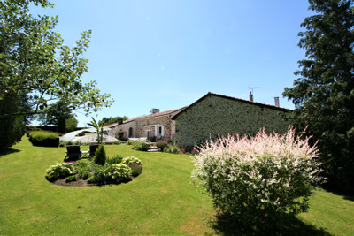 Fabulous property featuring a spacious 6 bed Charentaise country house with over 450m2 habitable space, independent 4 bed second house and swimming pool all set in a lovely 2ha park; quiet hamlet location with great views.