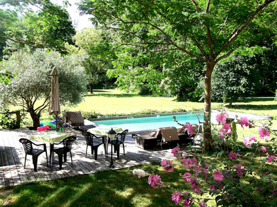 Luxurious Maison de Maître on 12 acres with pond, swimming pool, four newly renovated gites, five bedrooms, large garage, close to Nantes, walking distance to the village and 30 minutes to the Atlantic coast!