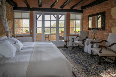 Exceptional ! Fully renovated stone property with 7 en suite bedrooms, separate 2 bedroom apartment, outbuildings, swimming pool and immaculate gardens with views - currently run as a succesfull high quality B&B.